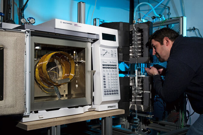 Researcher examining a technical apparatus
