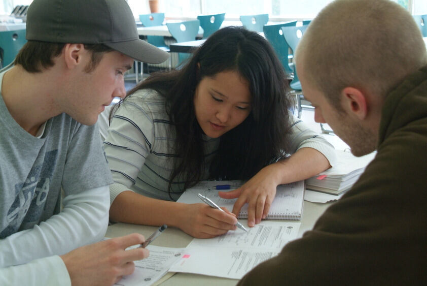 Three students working on an exercise
