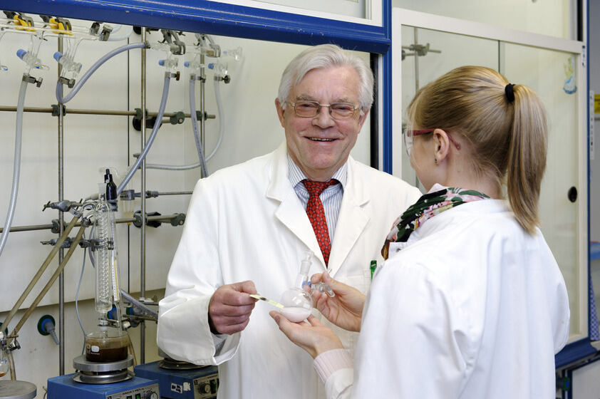 Professor Dieter Enders pictured in his laboratory, with Kristina Deckers
