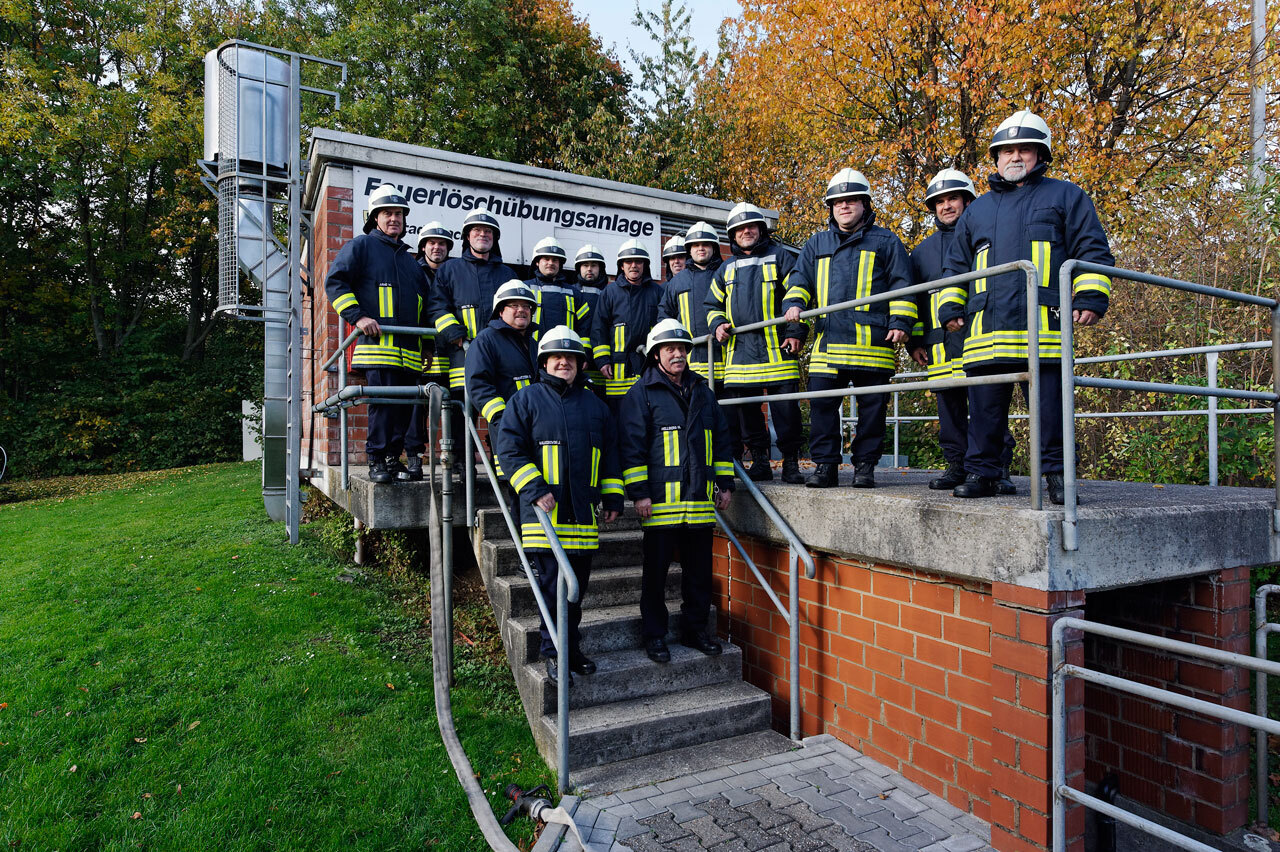 RWTH fire department team in uniform in front of the fire extinguisher facility