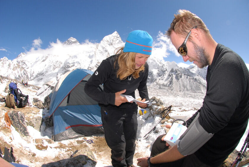 2 people doing research on Mount Everest