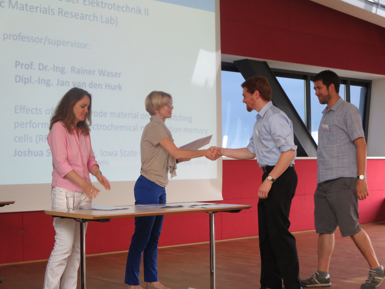 Professor Ute Habel, Rector's Delegate for Cooperation with the USA and Canada, hands out a UROP certificate