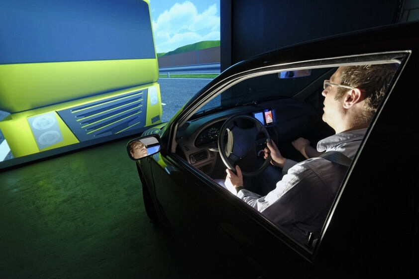 A driver in a car simulator