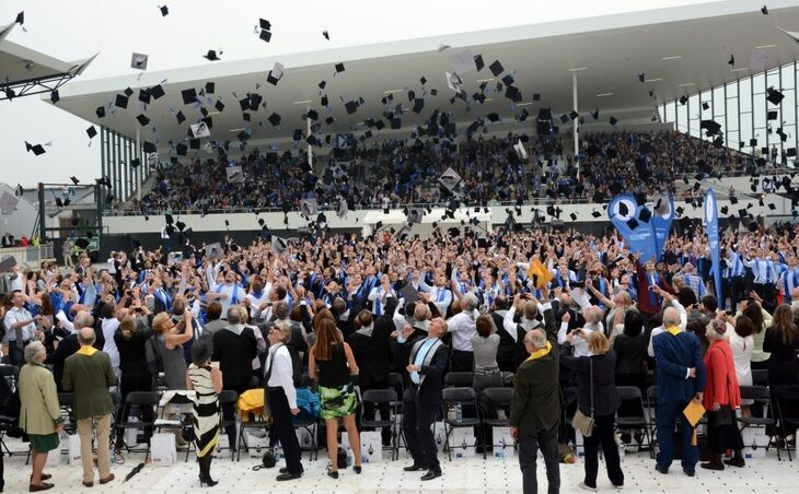 Graduates tossing their caps