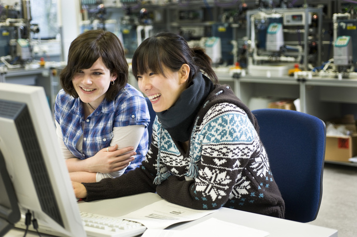 Two students sitting in front of a computer screen