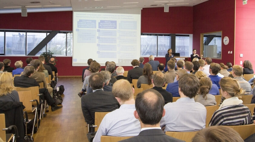 Participants of the Talk Lehre 2015 event listen to a presentation