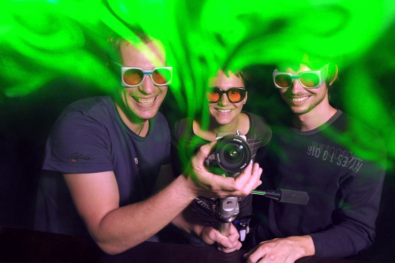 three young researchers with laser protection glasses