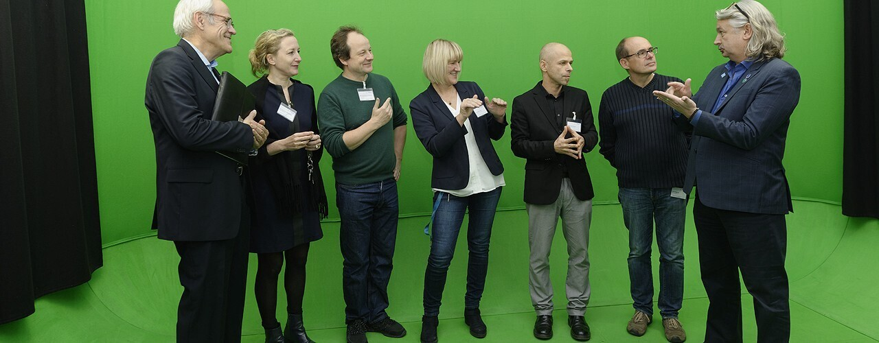 Group in front of a green screen