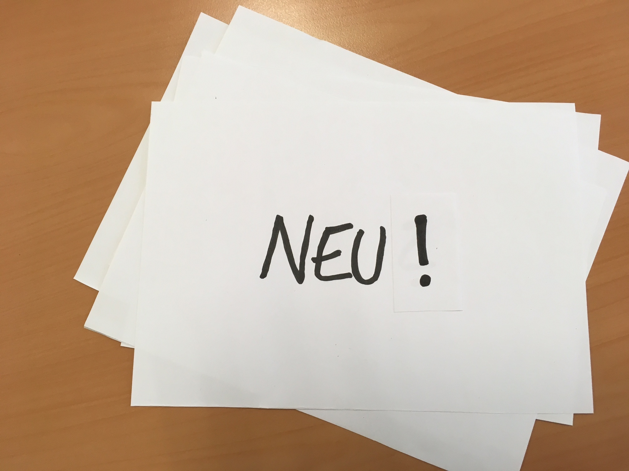 """Neu!"" - black writing on white background"
