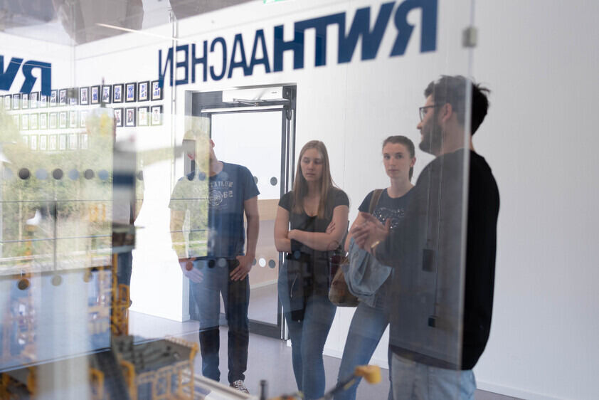Group of students in front of the AVT-Lego model